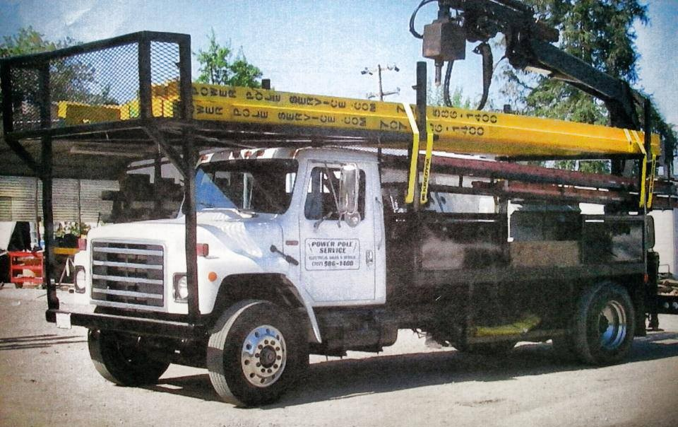 PPS truck carrying power poles